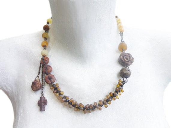 What We Try to Say. Chunky rustic asymmetrical assemblage necklace in shades of golden amber.