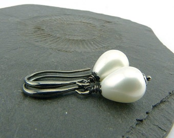 Pearl Drop Earrings. Shimmering white with metallic black. Lovely and timeless shell pearl jewellery. Feminine, monochromatic, timeless.