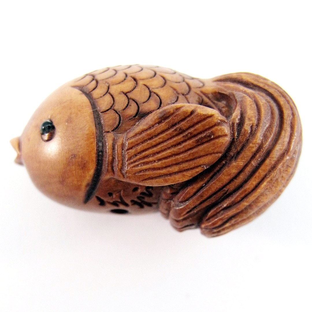 Puffy goldfish hand carved boxwood ojime bead