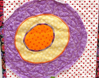 poppy wall quilt- single stem purple, orange, and yellow on red and white background READY TO SHIP