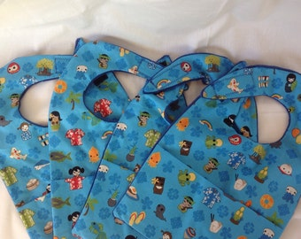 Baby bib with crumb catcher pocket with characters with an Asian and Hawaiian islands flair