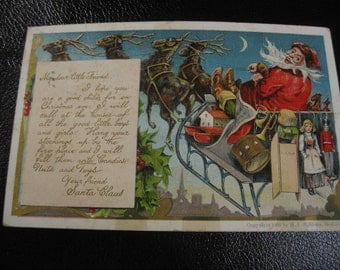 Vintage 1906 Postcard With Santa Claus and Sleigh Flying Through The Night, Toys On Back