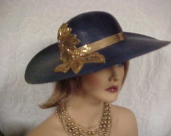 SALE.  Navy blue faux straw hat with sequined band and sequined side deco- fits 21-22 in
