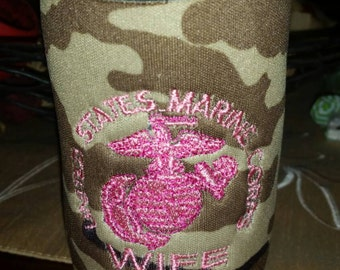 Camouflage, foam insulator/can cooler embroidered with Marine Corps wife and the eagle globe and anchor