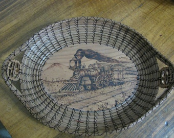 "Wood Burnt Image of an Antique Steam Engine, Center for oval ""Handmade in America"" Pine Needle Basket"