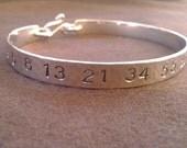 fibonacci bangle in copper, brass or sterling silver