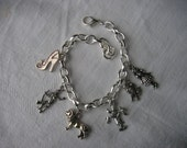 Wizard of Oz Charm Theme Bracelet, 6 charms on silver plated bracelet