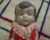 Antique Bisque Doll, Japan made. all four limbs move. Poka dot outfit on her
