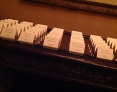 Classic Elegant Ivory and Black Fancy Script Escort Cards. Name and number on front.