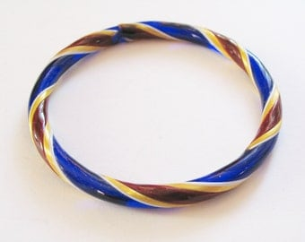 Antique glass bangle: Cute, preppy 1950s solid glass hand-blown, hand-painted bangle with gold, claret and midnight blue candy stripe design