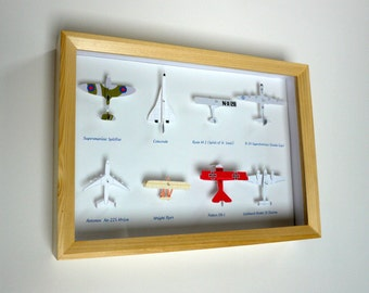 Paper aircraft case (just like a butterfly display case, but with airplanes)
