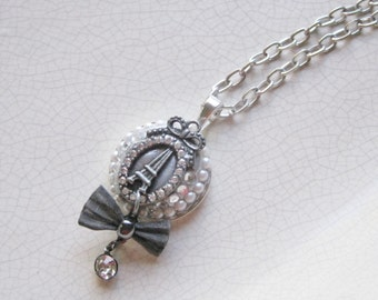 Eiffel Tower pendant necklace with rhinestones, pearls and black wire lace, matching earrings