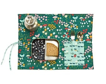 Picnic placemat in organic fabric with cute ants, mushrooms and flowers. Spring pocket place mat in green, red and yellow.