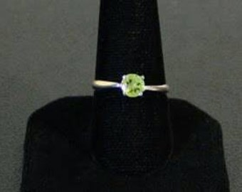 Sterling silver and peridot faceted gemstone ring