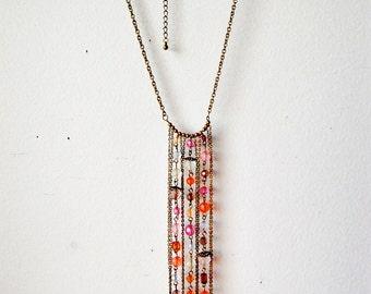 Vintage Jewelry Multistrand Boho Tassel Dangle Necklace of Translucent Beads 1970s.