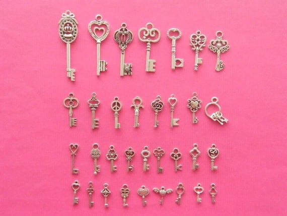The Unbelievable, Can It Be True Key Collection - 33 different antique silver tone key charms