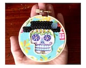 Funky Embellished Day of the Dead Halloween 3-Inch Skull Hoop Art with Black Hat, Blue Camellia, Sequins