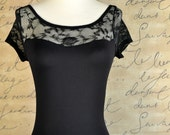 French black lace short lace sleeve leotard with low back. Coordinates with many tutu tulle skirts at TutusChic.