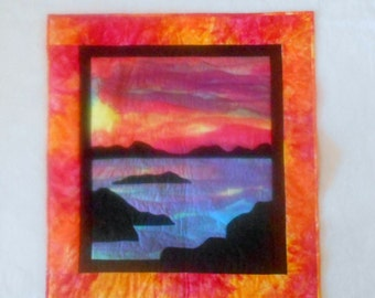 Quilted Wall Hanging - Sunset Over the Water in Sunset Colors and Blues and Black