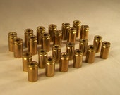 24 Brass bullet shells with removed primers- 9mm and .40
