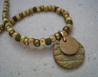 Green and Beige Glass Seed Bead Bracelet with Bronze Stacked Disks - Charm Bracelet - Green Bracelect
