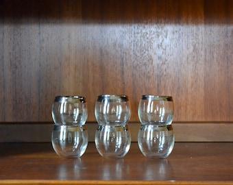 vintage mismatched 1960s silver rim roly poly shot glasses