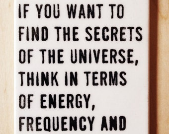 porcelain wall tag screenprinted text if you want to find the secrets of the universe, think in terms of energy, frequency...-nikola tesla.