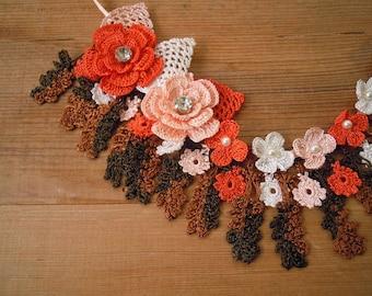 orange and brown crochet necklace, bib, flower