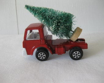 1970 Tootsie Toy Truck With A Bottlebrush Tree