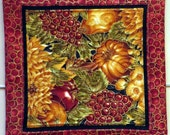 Set of four Hot Pads Mug Mats Quilted apples pumpkins cranberries
