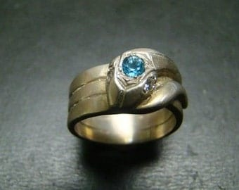 Wonderful Sterling Silver Snake ring with blue topaz and genuine diamonds