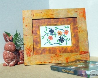 Orange picture frame reuse vegan orange yellow tie dyed collage on wide wood border and matte with orange and black ink flower sketch