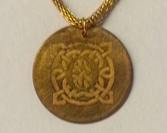 Etched brass pendant with Celtic knot and Oregon O on gold colored lantern chain