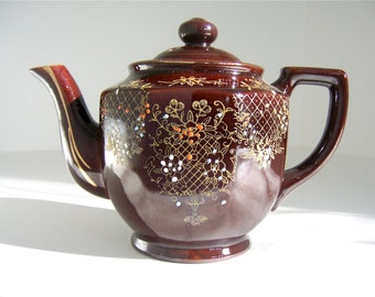 Teapot, brown glazed redware 1940s vintage moriage style hand painted orange white blue gold floral lattice pattern ceramic tea time, Japan