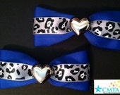 Blue and silver heart hair bows. Portion of sale goes to charity.