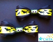 Green and black bat hair bows with googly eyes! Portion of sale goes to charity.