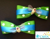 Green and blue hair bows with bumble bees. Portion of sale goes to charity.