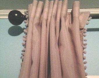 One shade of Gray Curtain with Gray Pom Pom Trim