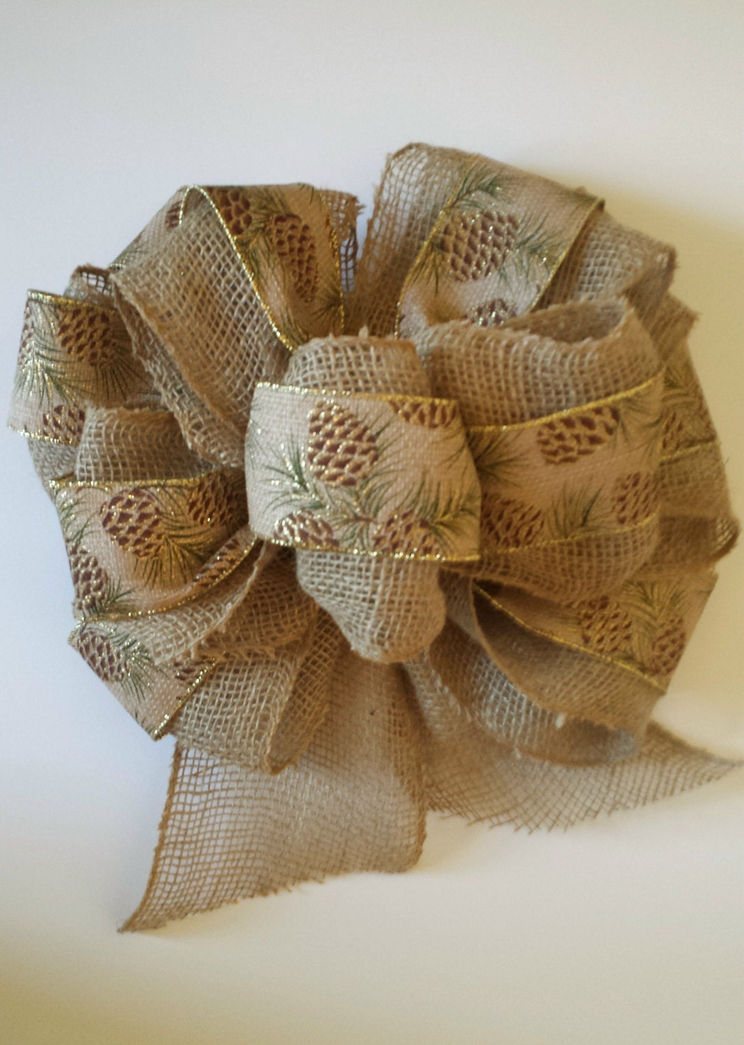 Burlap christmas tree topper bow with pine cone ribbon for Burlap ribbon on tree