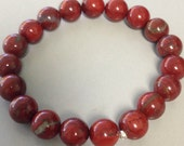 Brecciated Flame Red Jasper 10mm Round Bead Stretch Bracelet With Sterling Silver Accent