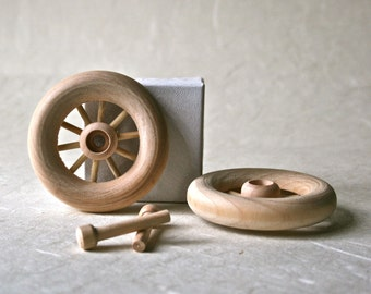 """Hardwood 2 1/2"""" Wheels with Spokes and Axle Pegs for Craft Projects"""