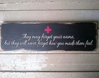 They May Forget Your Name but They Will Never Forget How You Made Them Feel painted wooden sign by Dressing Room No. 5