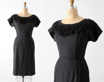 1960s black dress with avant garde neckline