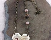 ON SALE 25% OFF Pawprints on my Heart Polymer Clay faux bone/ivory necklace - Benefit for Andrea
