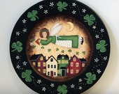 St Patricks Day Folk Art Hand Painted Wooden Plate - MADE TO ORDER -  Irish Angel tossing shamrocks and daisy flowers over saltbox village