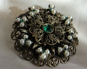 Vintage brooche gold tone white beads and green stone