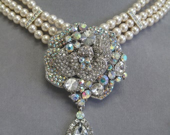 Three strand Swarovski pearl bridal necklace with crystal rhinestone focal.