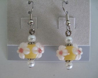 Yellow and white floral lampwork glass bead earrings