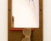 The Elefuction Mirror Small in Wheat board with key holder magnets and red eyewear bungee.