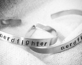 team nerdfighter cuff set: two hand stamped 1/4 inch aluminum John Green nerdfighter vlogbrothers cuffs